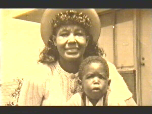 barry white with mother young boy